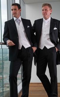 Left: Black Informal Jacket, Black Trousers, Finesse Porcelain Waistcoat, Gunmetal Tie and Handkerchief Right: Black Prince Edward, Black Trousers, Mexico White Waistcoat, White Scrunch Tie and Handkerchief