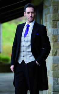 Classical black tailcoat with silver / violet tweed waistcoat and satin violet tie and hankie
