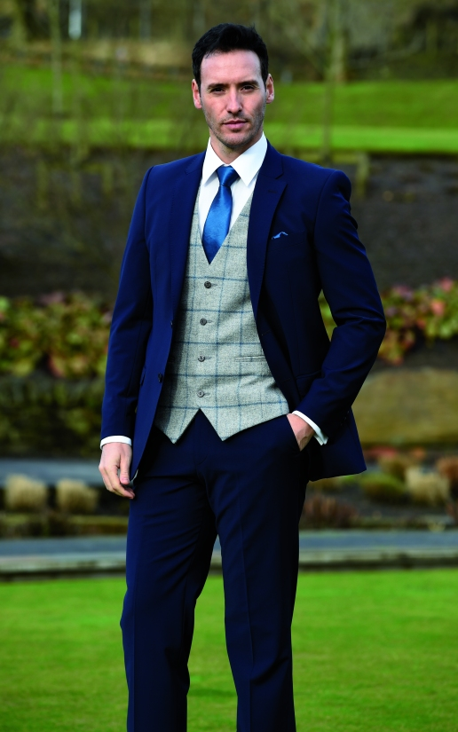 Blue Ultra slim fit suit with Windsor tweed waistcoat . Marine Taffeta tie and handkerchief